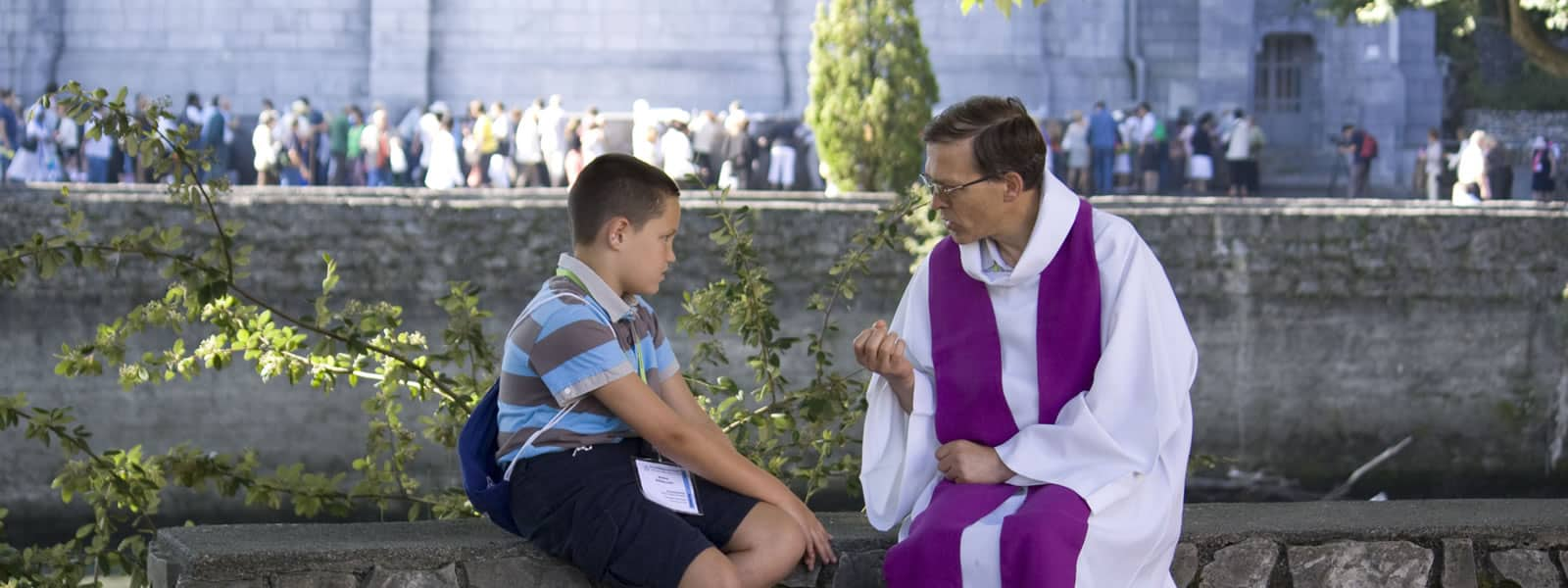 Child Goes to Confession Sitting with Priest