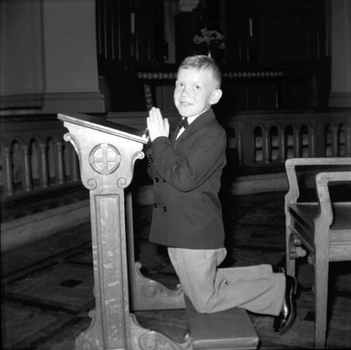 Boy Kneeling at Mass