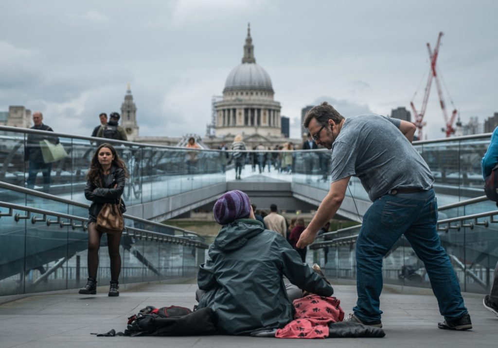 Man offering help to a homeless person