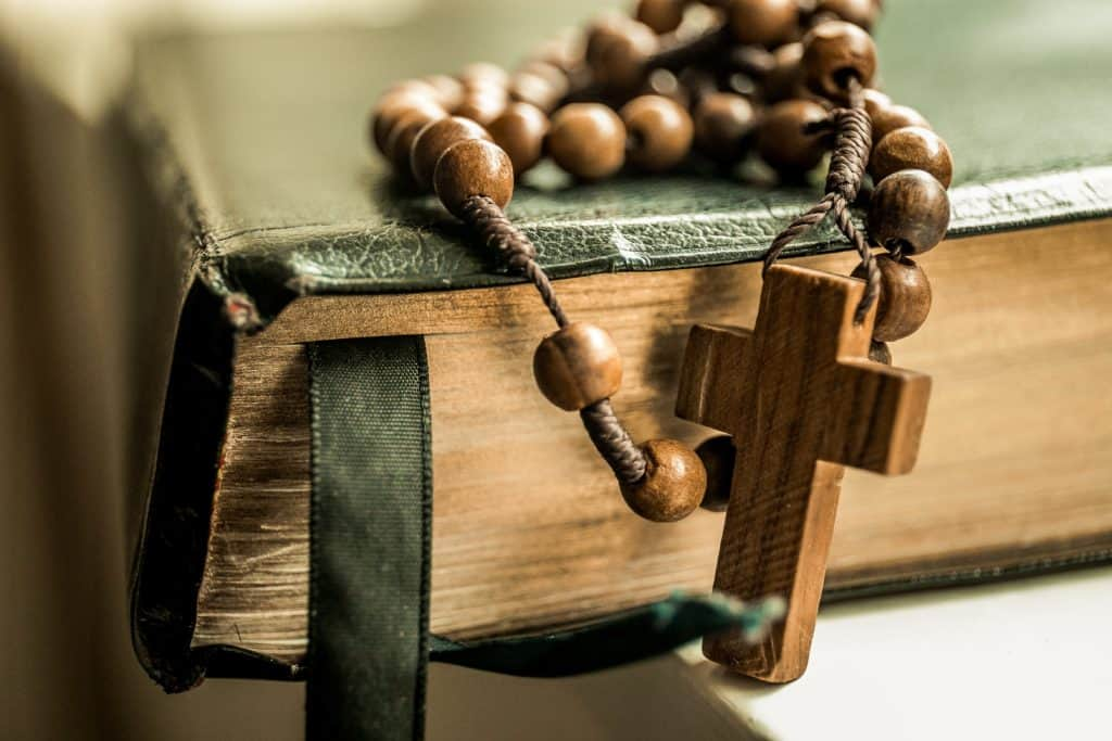 wooden rosary on a bible