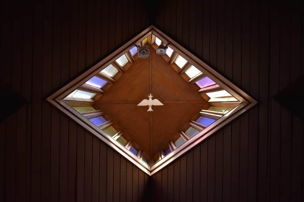 triangular brown and purple decor with dove bird art