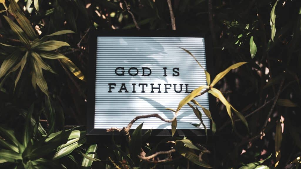 God is Faithful signage with leaved background